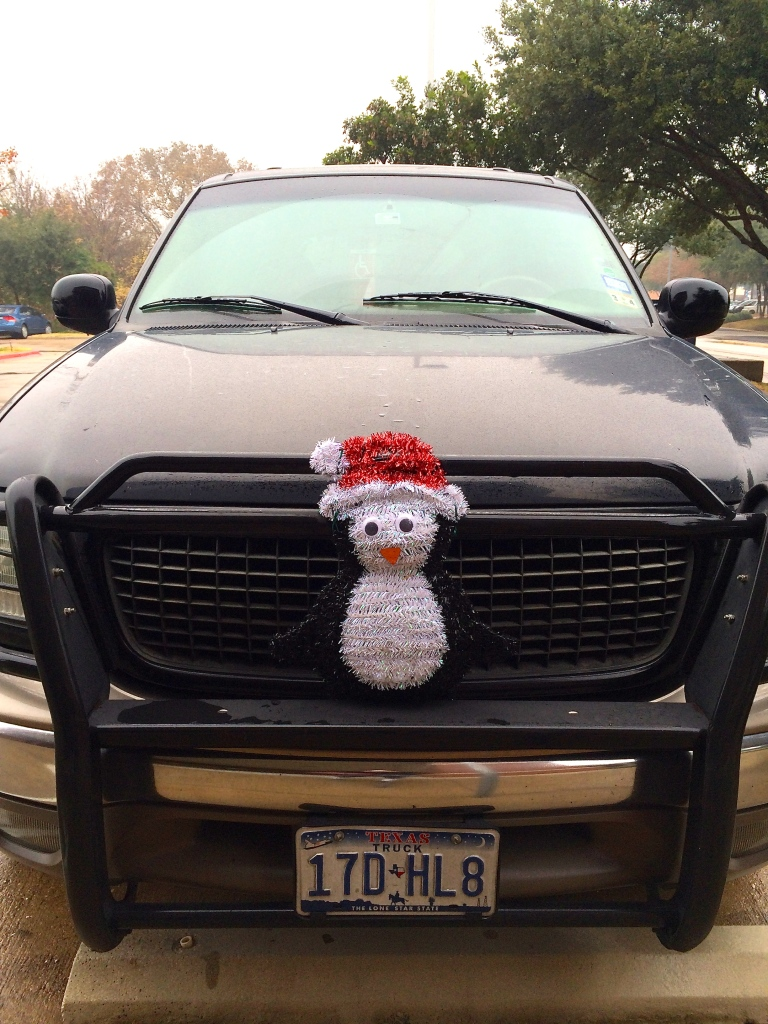 Santa Penguin got run over by a truck.
